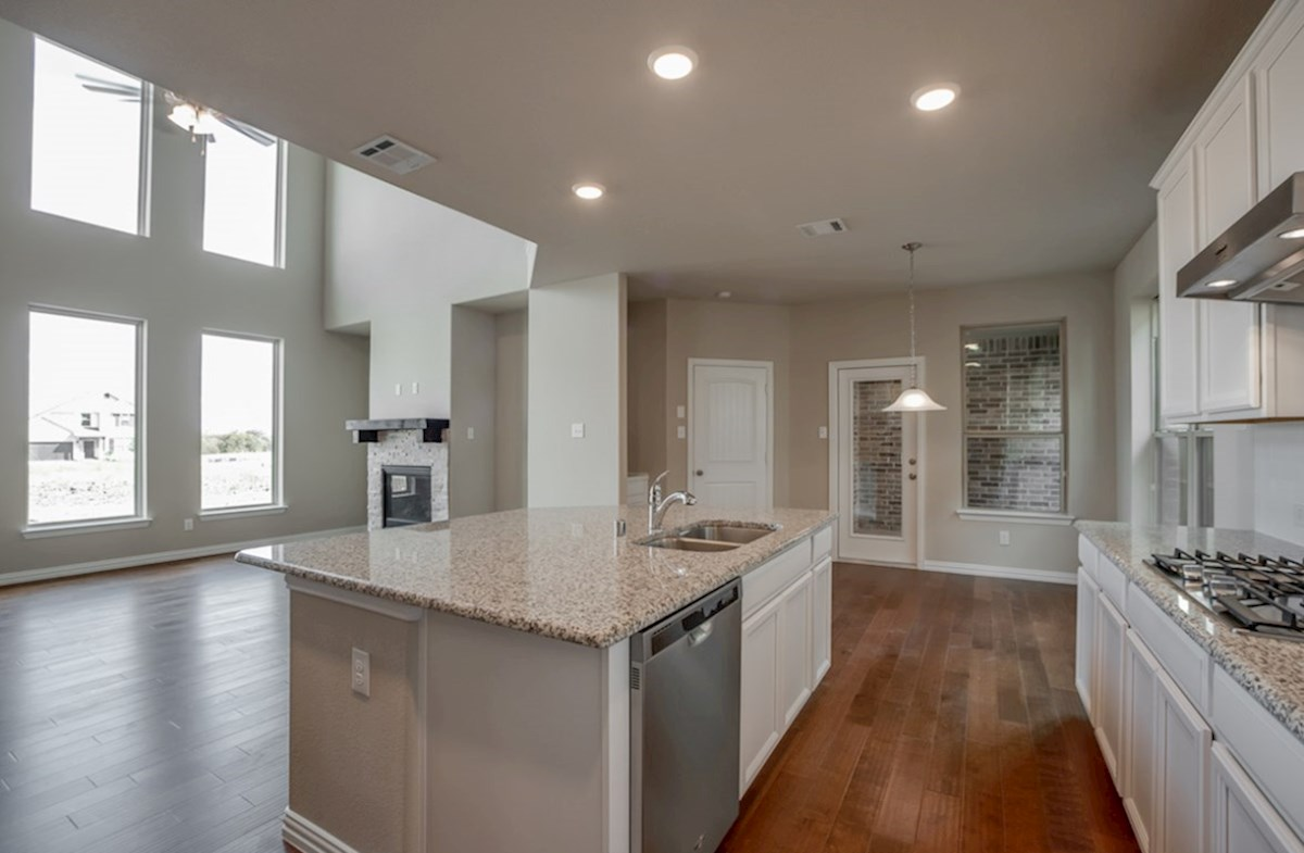 Fairfield quick move-in kitchen with island and white cabinets