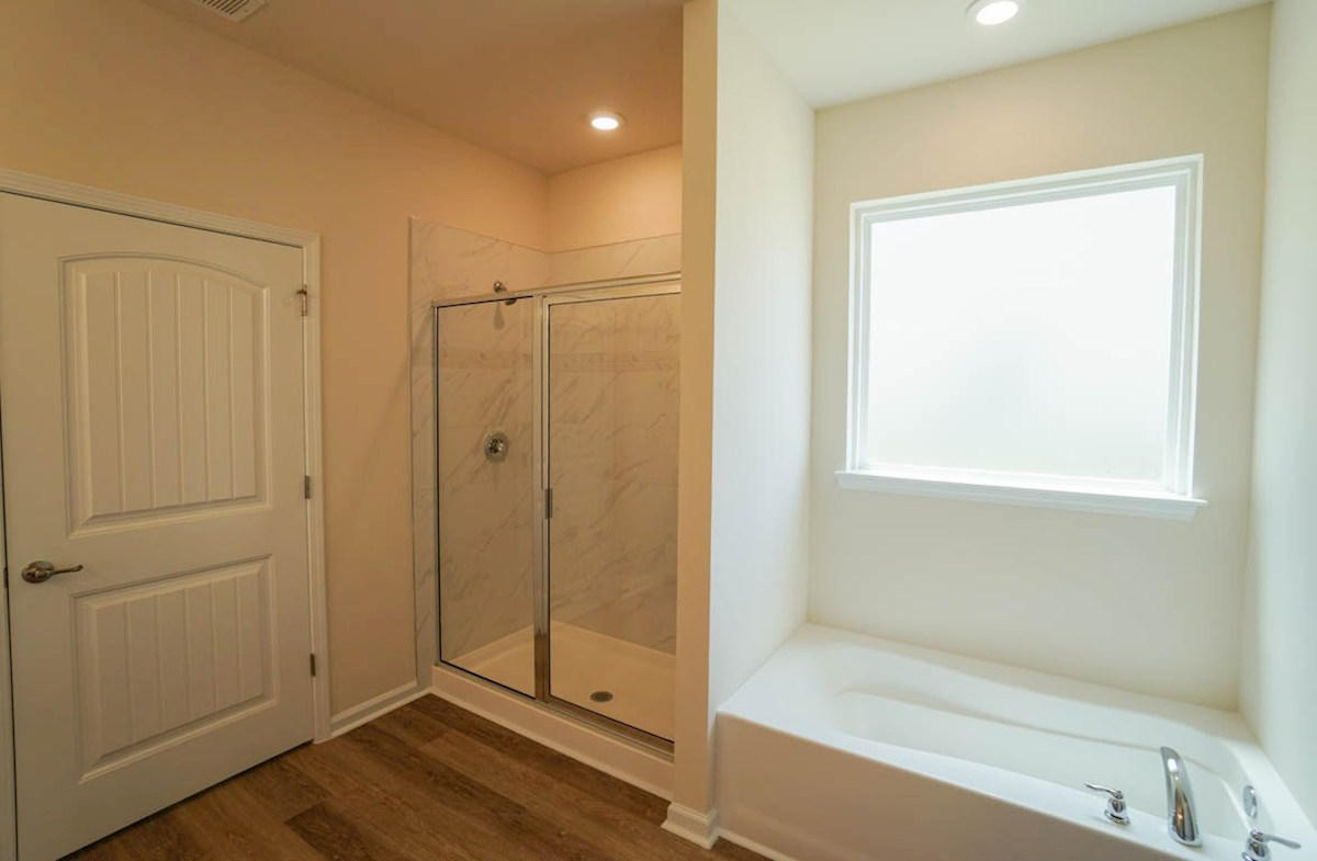 Camden quick move-in master bathroom features shower and bathtub combo