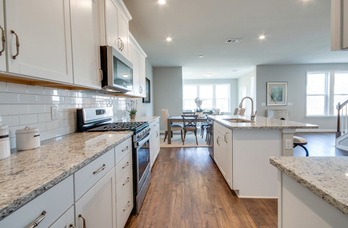 Nichols Vale Ashford kitchen with hardwood floors and white cabinets