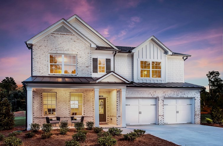 Two-story home with 2-car garage & front porch