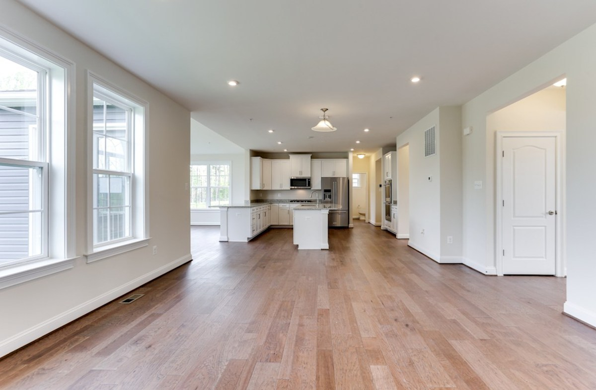 Brookview quick move-in Brookview kitchen and great room featuring hardwood