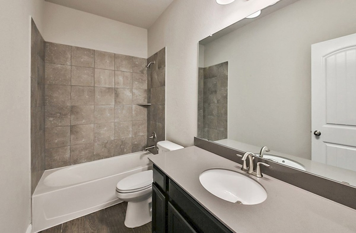 Anderson quick move-in guest bathroom with tile flooring and silestone countertops