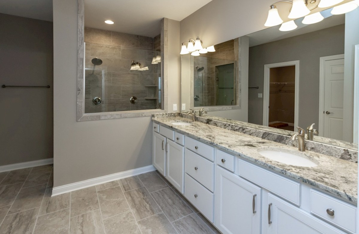 Bradbury quick move-in Master bath with dual sinks and spa shower