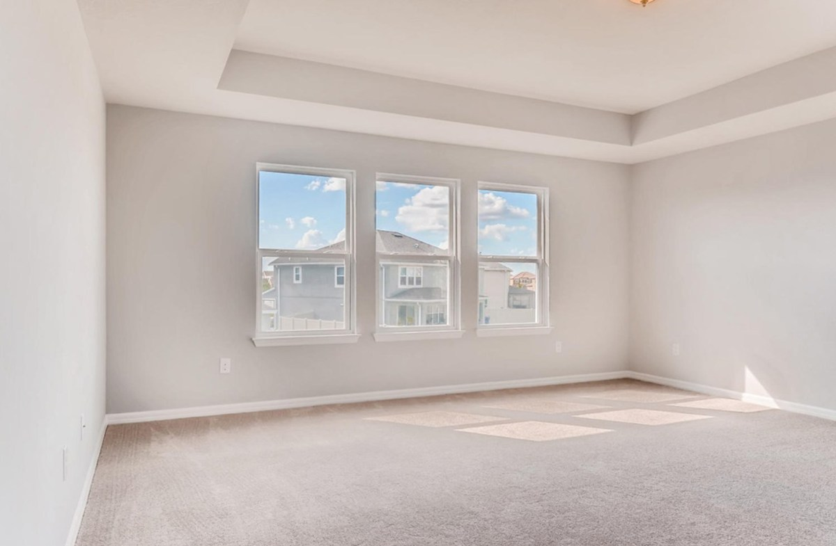 Sequoia quick move-in Master bedroom with a tray ceiling and large windows