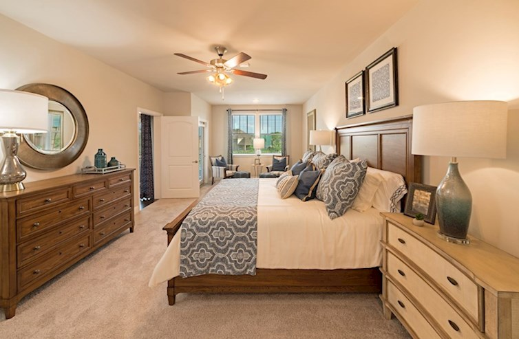 Gatherings® at Westview Dorset master bedroom with carpet flooring and seating area