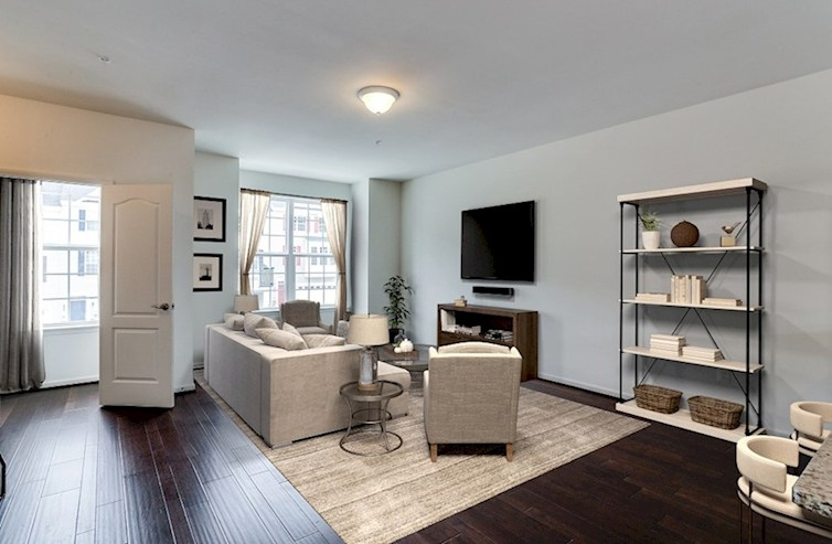 Oakland quick move-in Spacious great room featuring hardwood floors