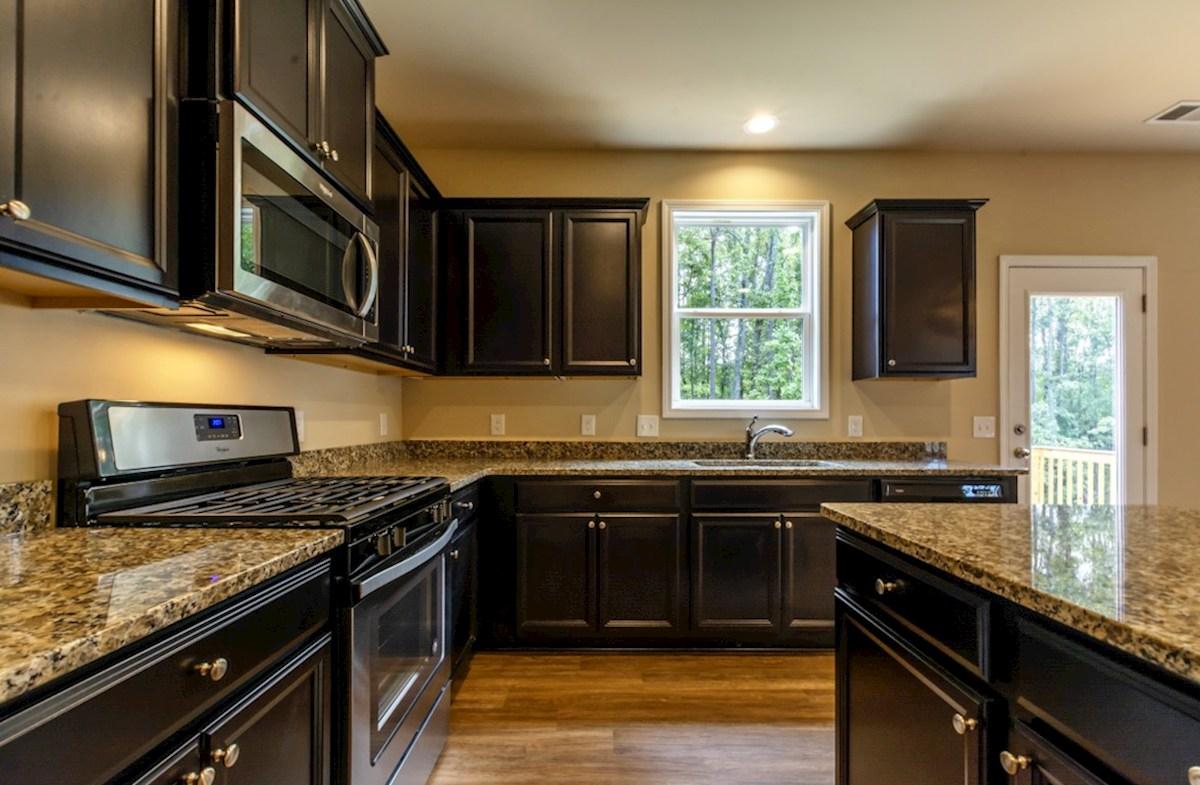 Milford Point Duval Kitchen with dark brown cabinets