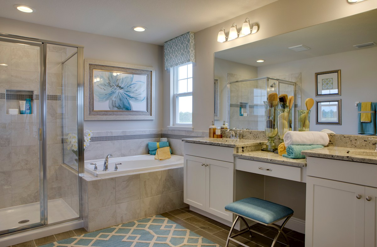 Long Lake Ranch Townhomes Erie Spa-inspired master bathroom with dual vanity and garden tub