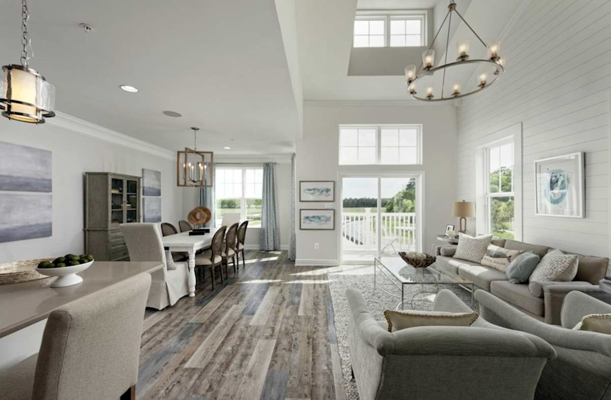 Harbor Crest at Bayside Fenwick Living and dining room feature hardwood floors and large windows