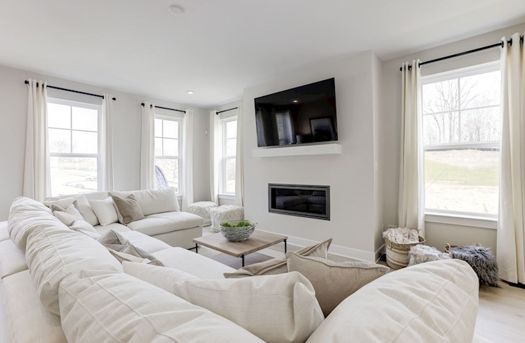great room with large sectional & fireplace