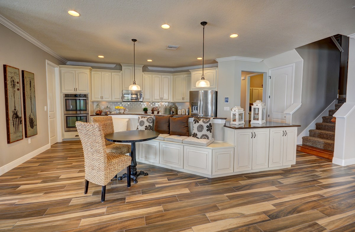 "The Reserve at Pradera Redwood Kicthen with white 42"" cabinets and large center island"
