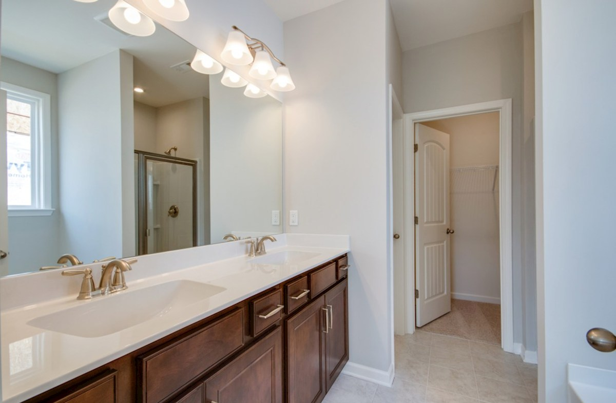 Harper quick move-in master bath with double sinks and soaking tub