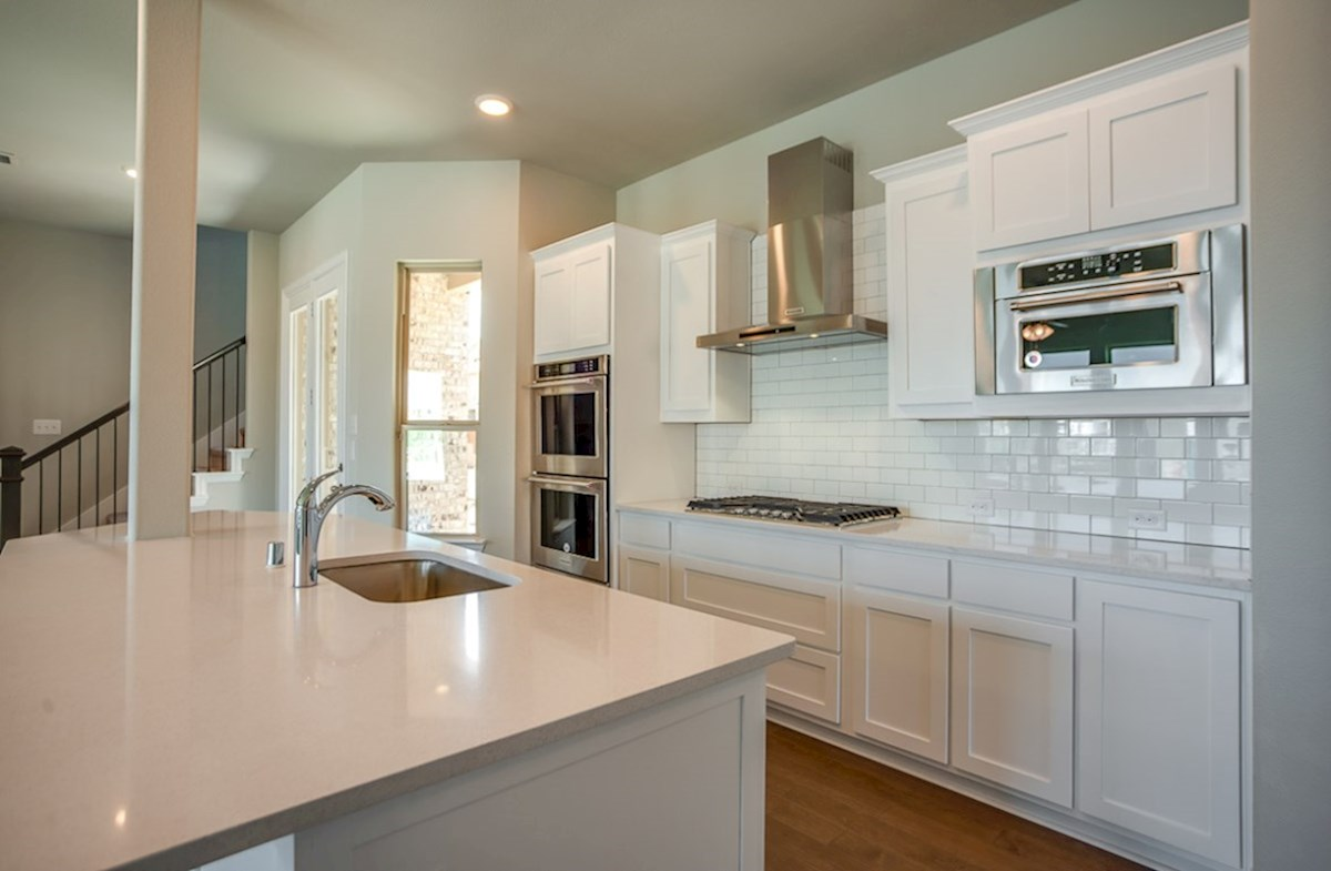 Eastland quick move-in kitchen including stainless steel appliances