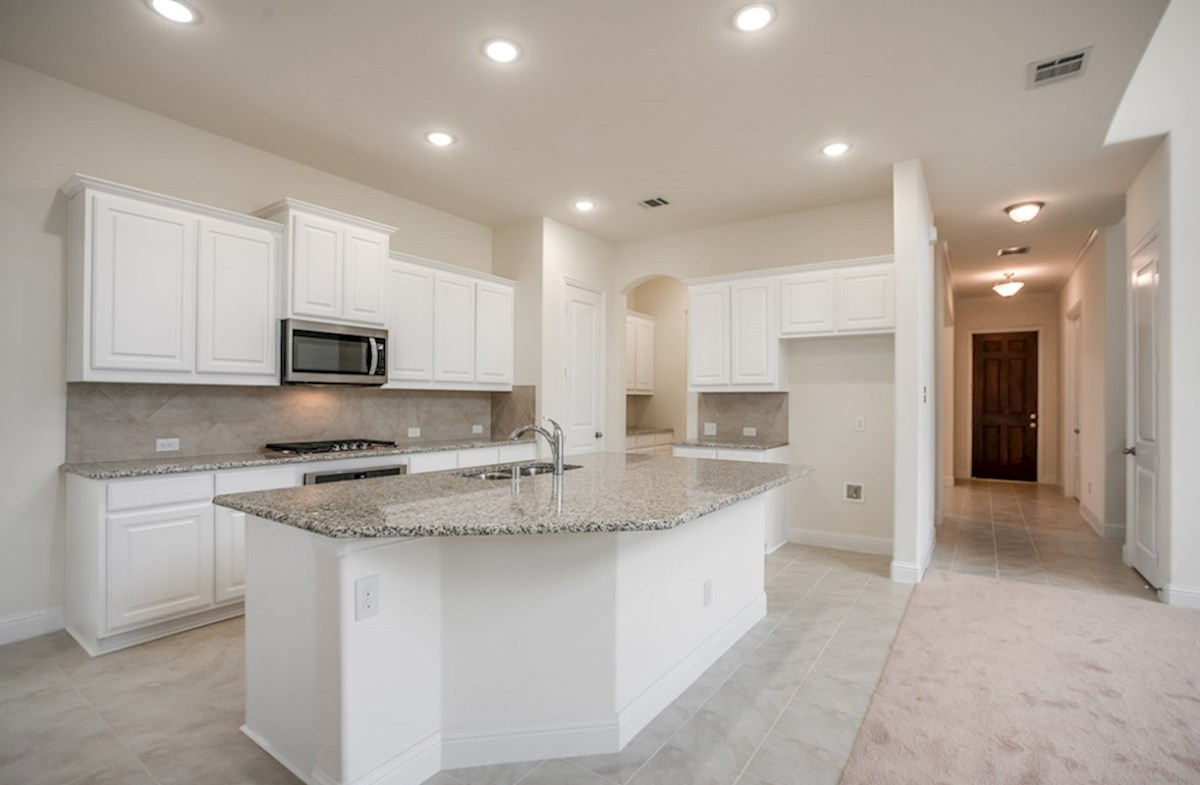 Whitney quick move-in open kitchen with white cabinets and tile floor
