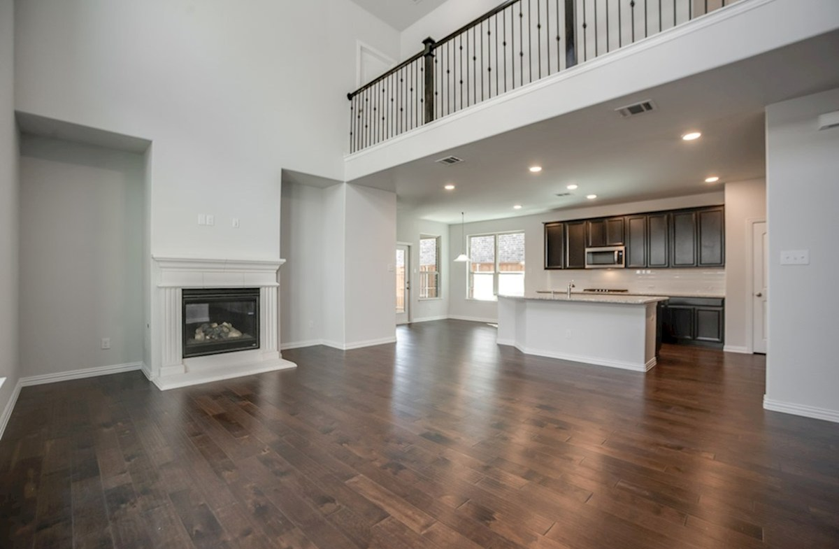 Whitney quick move-in open great room with wood floors and fireplace