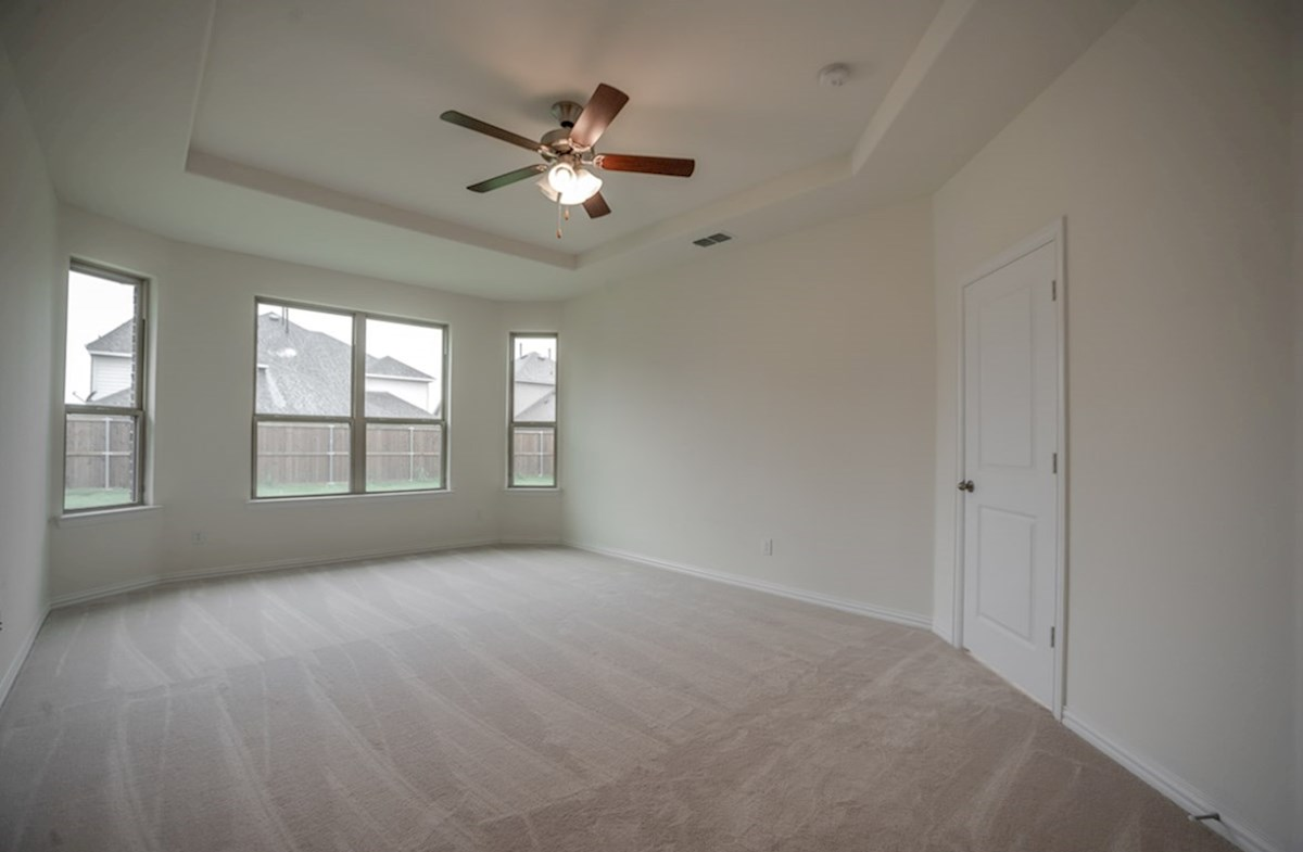 Silverado quick move-in master bedroom with large windows and carpet