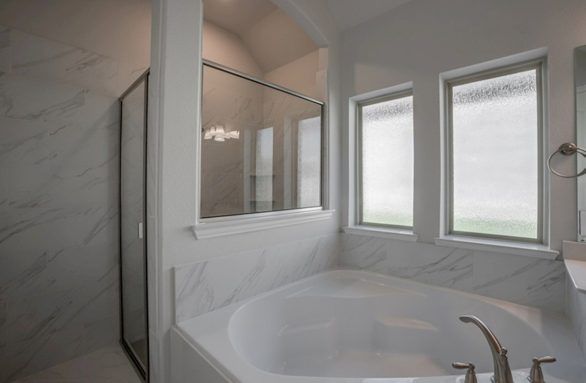 Miramonte Bandera Bandera master bathroom with separate tub and shower