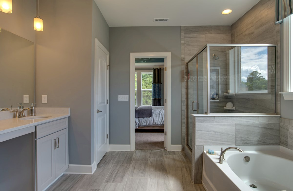 master bath with show and soaking tub