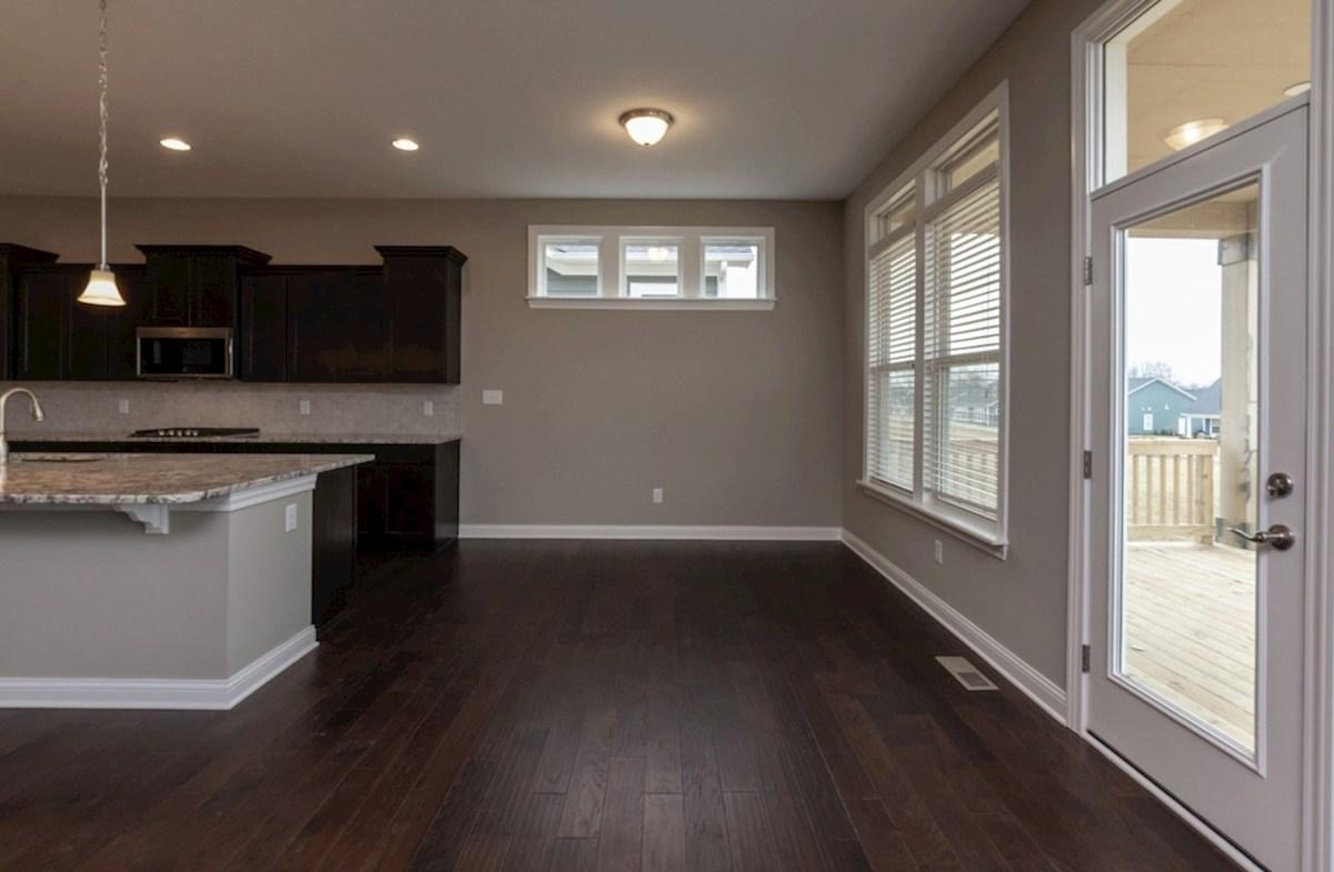 Windsor quick move-in breakfast area with hardwood floors