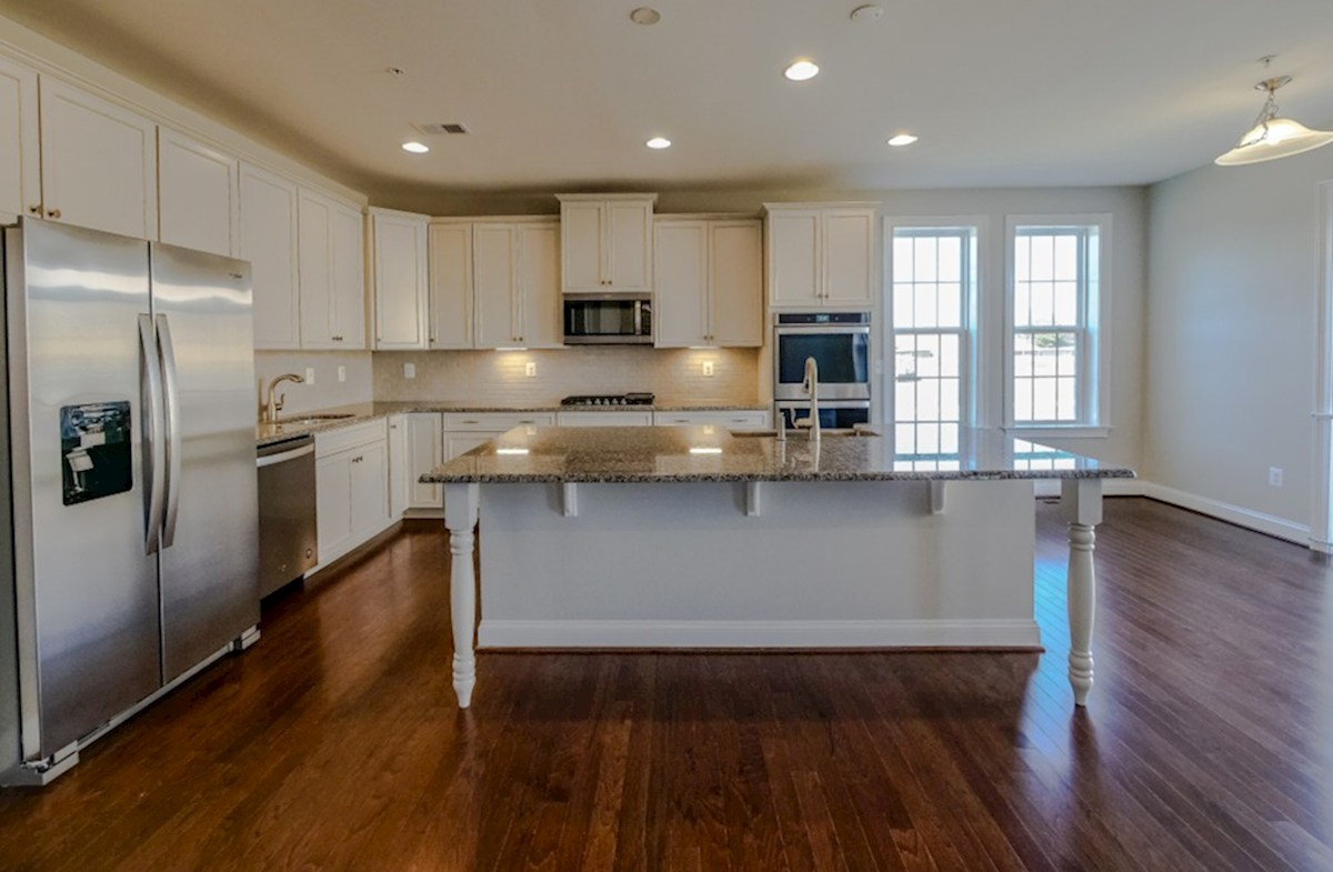 Old Court Crossing Cooper Cooper kitchen featuring granite and stainless steel