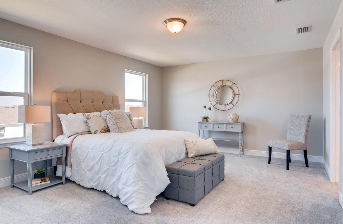 Reserve at Citrus Park Sand Dollar Master bedroom with backyard views