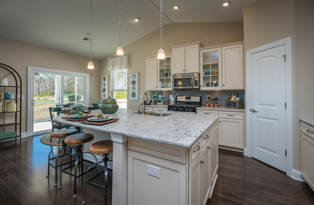 open kitchen with breakfast area