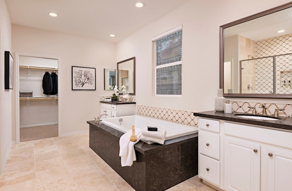 Floresta Prado Spa-inspired luxury abounds in the deluxe master bath, complete with separate shower and soaking tub
