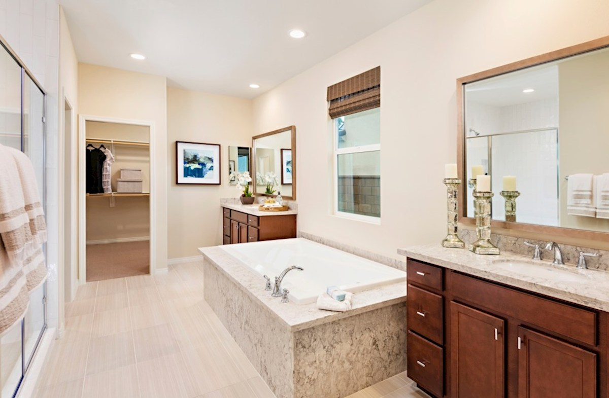 Floresta Toluca Spa-inspired luxury abounds in the deluxe master bath, complete with separate shower and soaking tub
