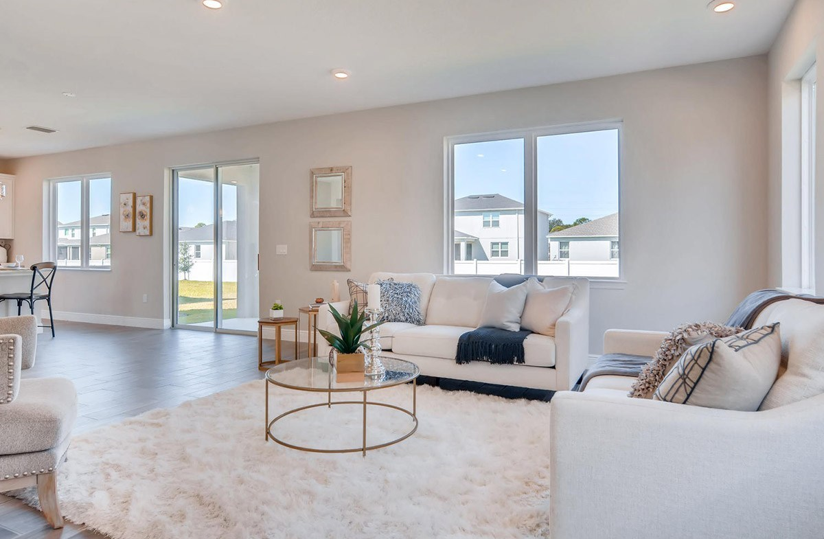 Reserve at Citrus Park Sand Dollar Open great room with large windows for natural light