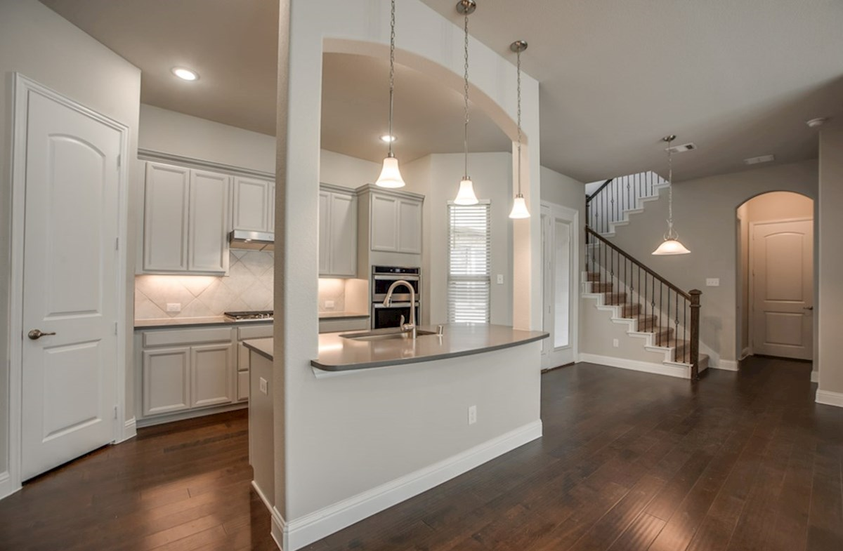Eastland quick move-in open kitchen with large island and grey cabinets