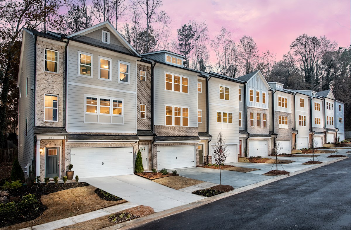 Three-story townhomes with front-loading garage