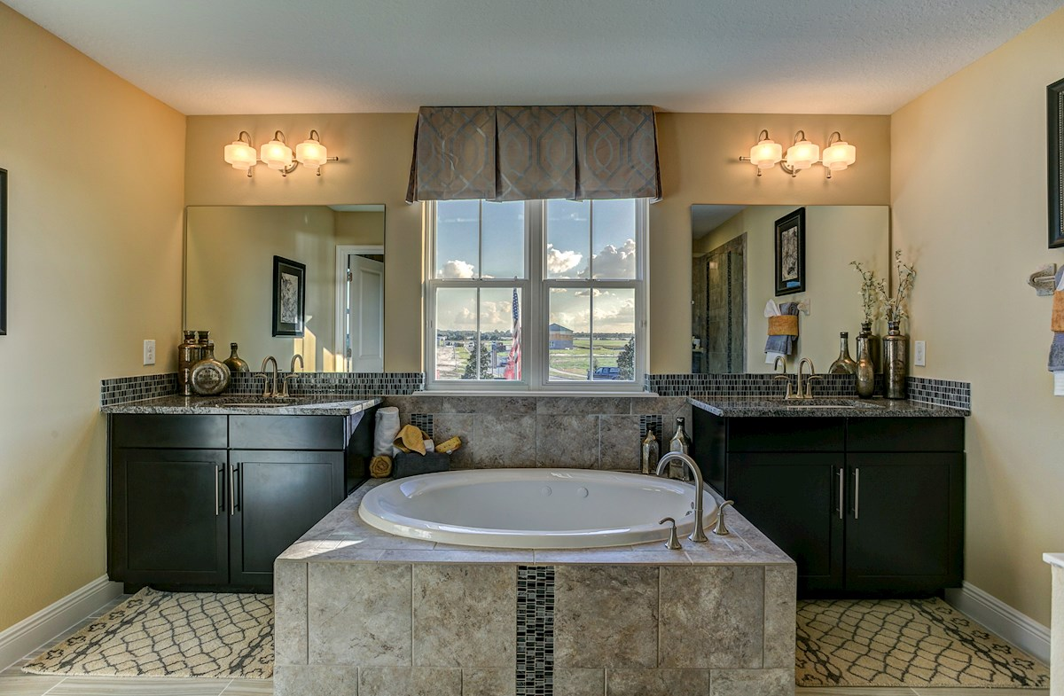 The Reserve at Pradera Sequoia master bathroom with garden tub and seperate vanities