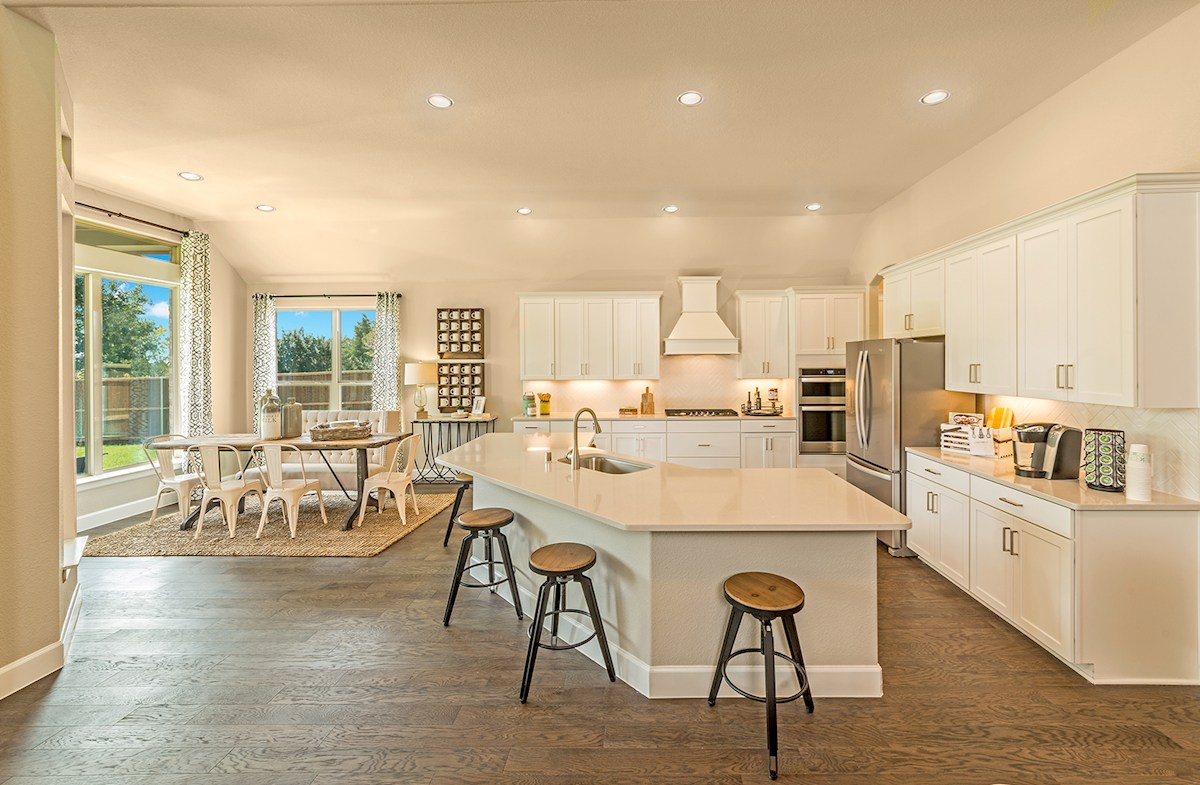 kitchen opens to breakfast area and great room
