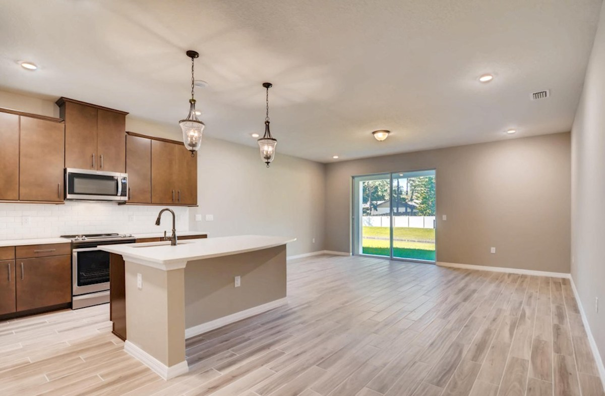 Siesta Key quick move-in Open kitchen and great room with wood-look tile