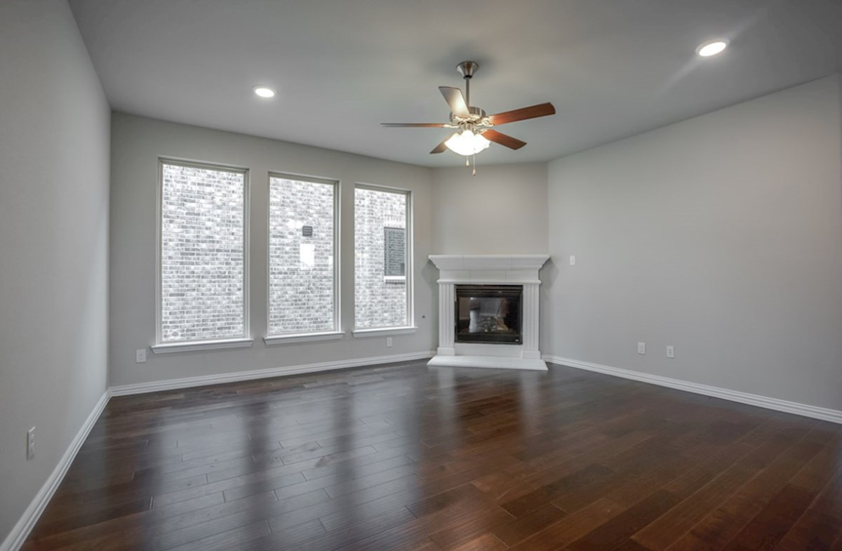Eastland quick move-in great room with large window and ceilng fan