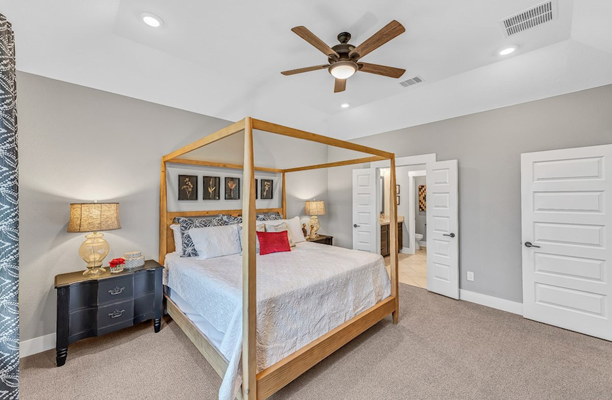 Bridgeland: Harmony Grove Messina cozy master bedroom with plush carpet flooring