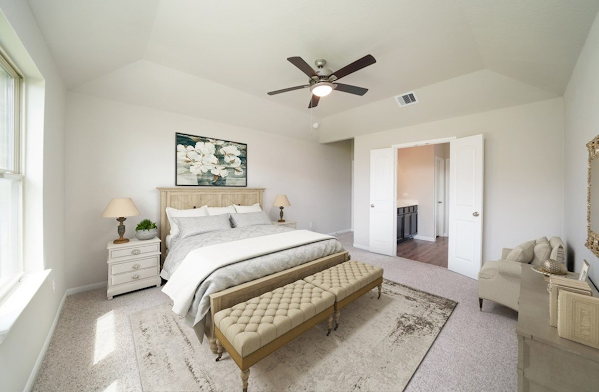 Lantana Sierra master bedroom with ceiling fan and carpet flooring