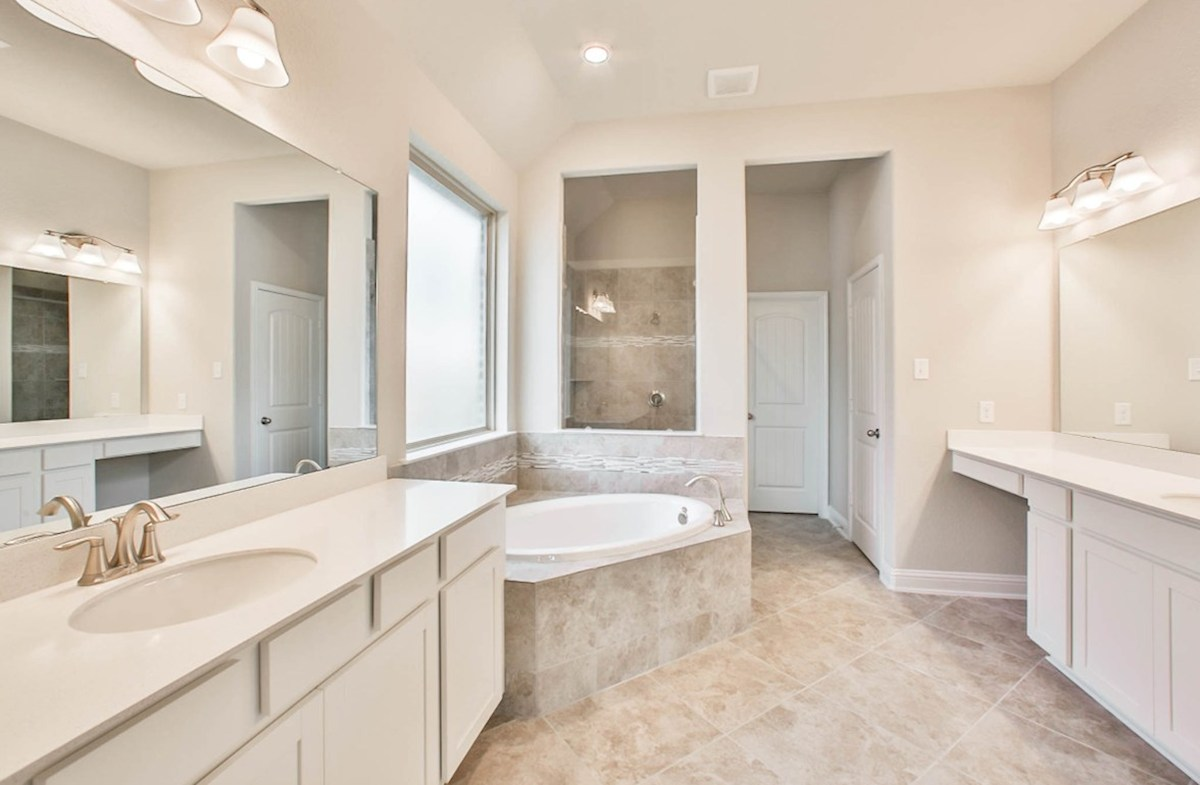 Fredericksburg quick move-in master bath with tile floor plus separate tub and shower