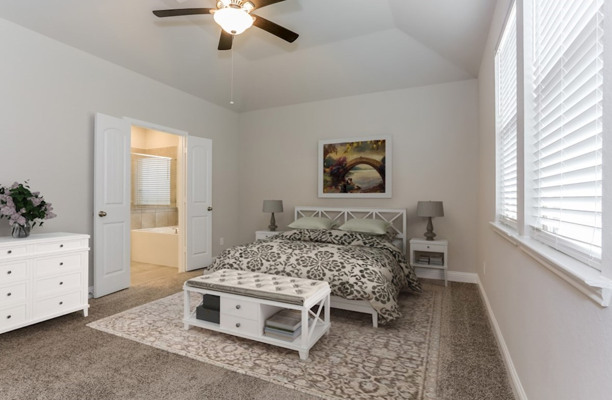 Lantana Berkshire master bedroom with carpet and ceiling fan