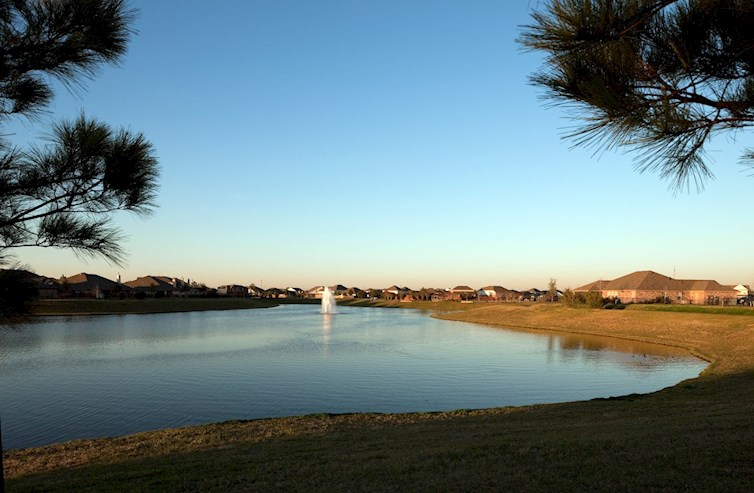 Scenic community lake boasts a water fountain