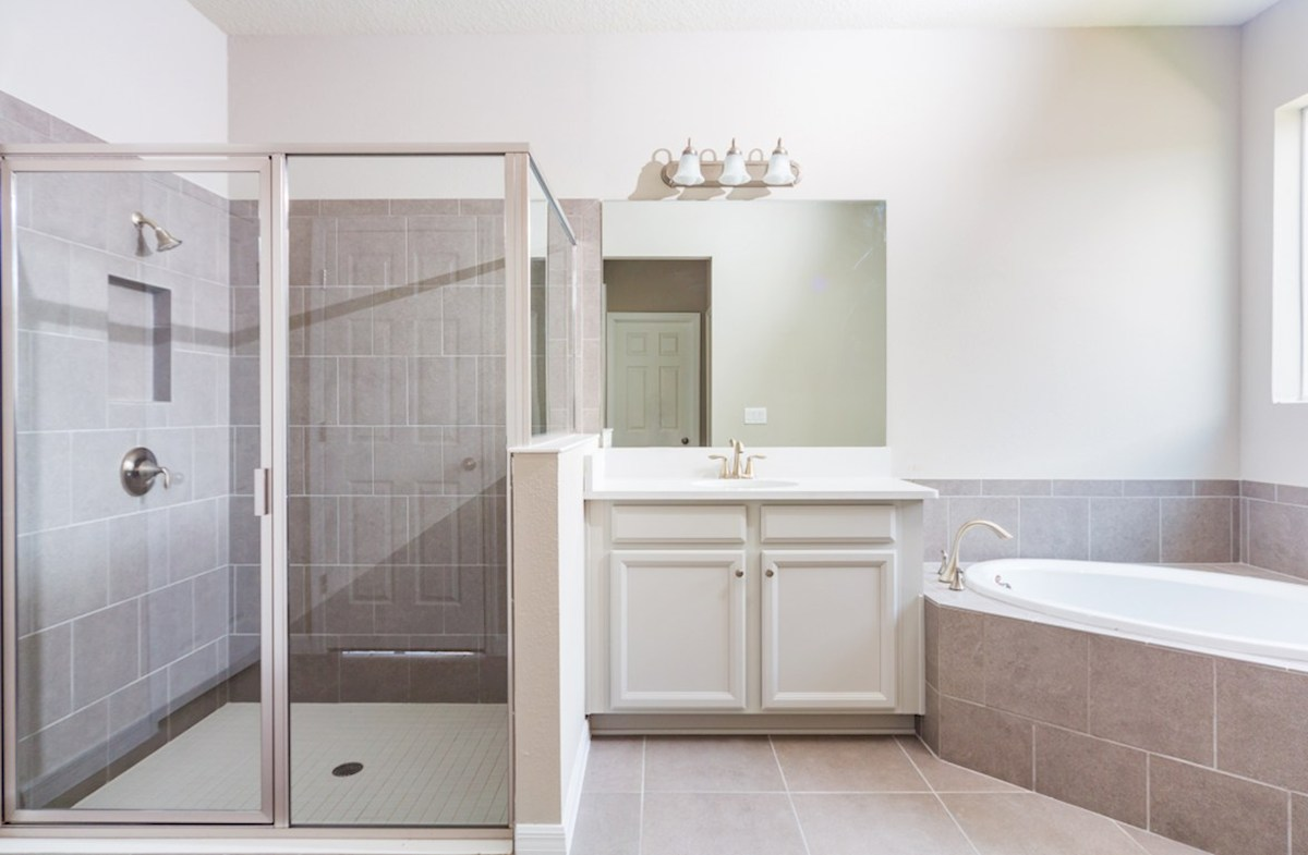 Redwood quick move-in Master bath featuring frameless glass shower and seperate vanities