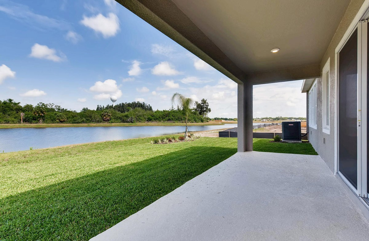 Bayview quick move-in Large covered rear lanai with pond views