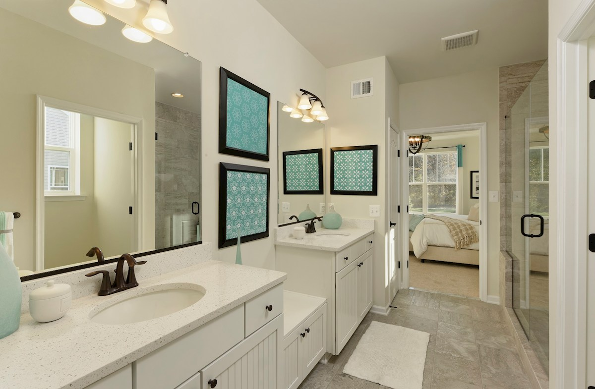 The Estuary Georgetown Spa-inspired master bath featuring two individual vanities
