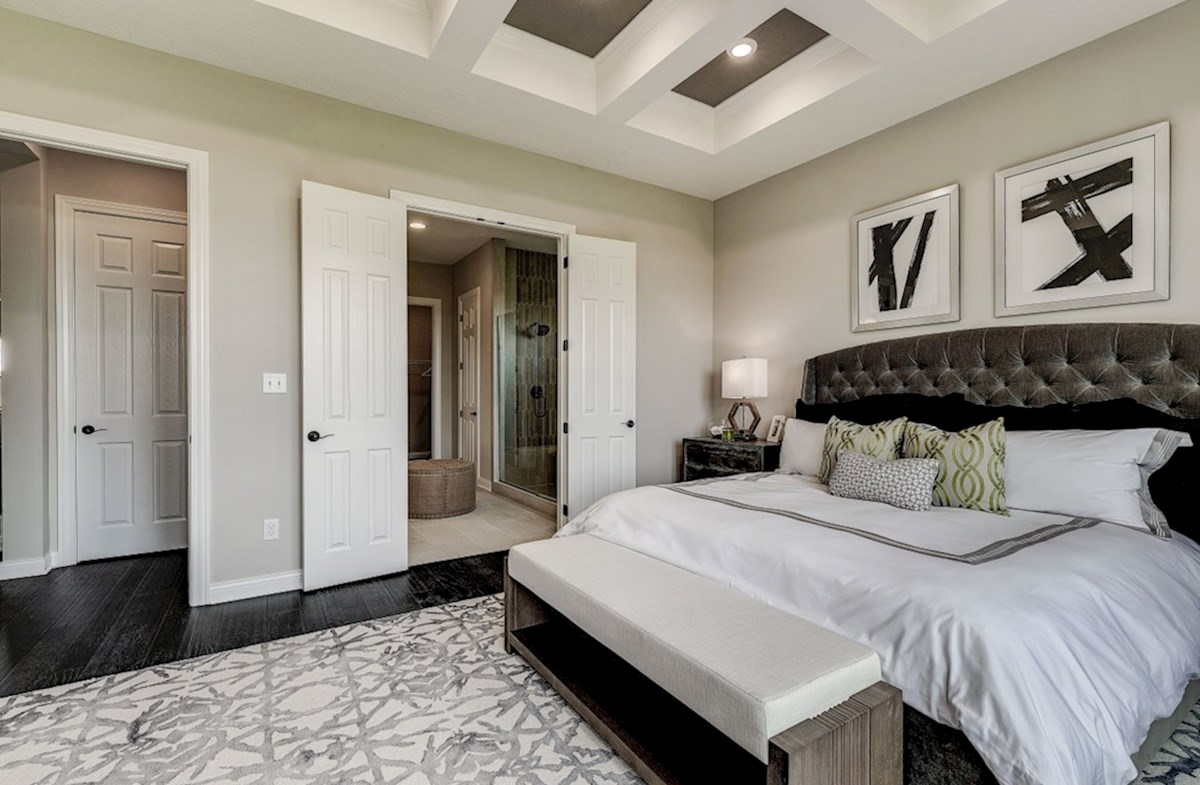 Hampshire Meridian Collection Delaware master bedroom with hardwood floors and attached bath
