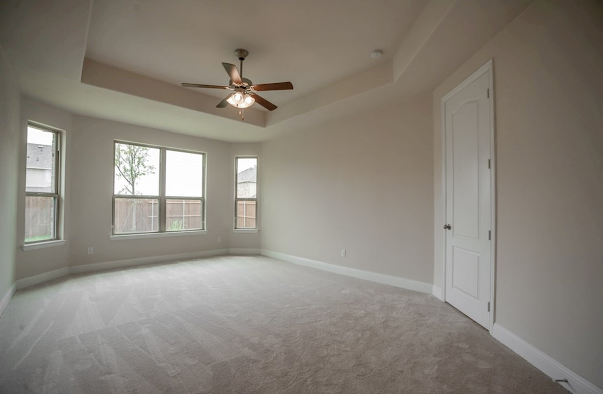 Silverado quick move-in master bedroom with tray ceiling and ceiling fan