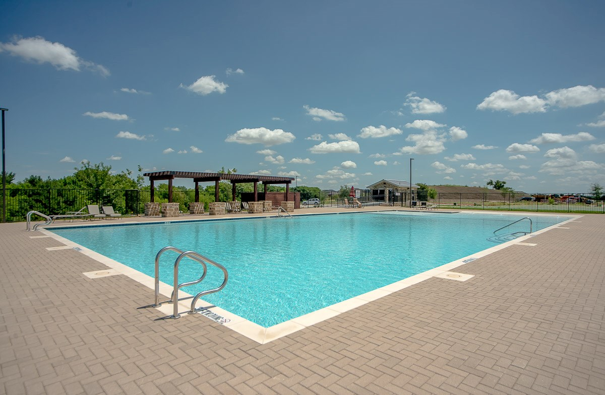community pool with lounge chairs
