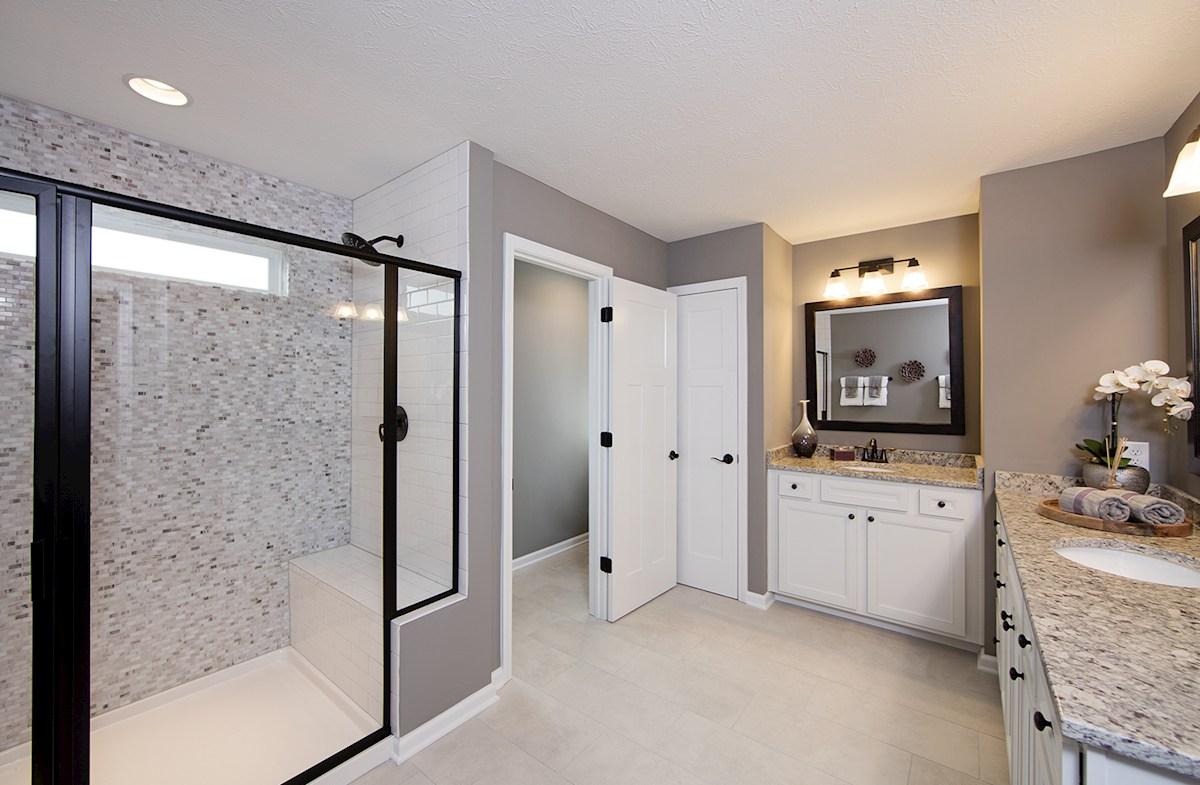 Summerland Park Shelby master bath with dual vanities and spa shower