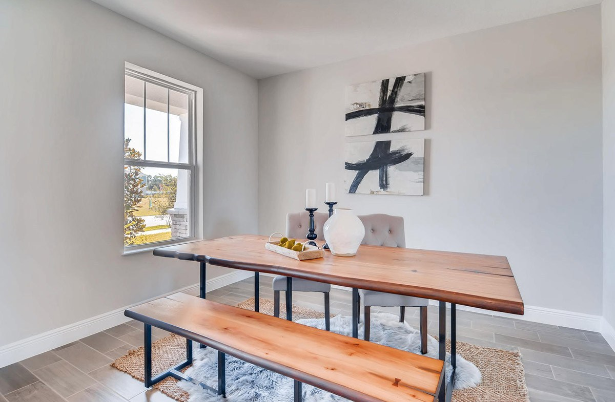 Reserve at Citrus Park Sand Dollar Dining room with large windows for natural light