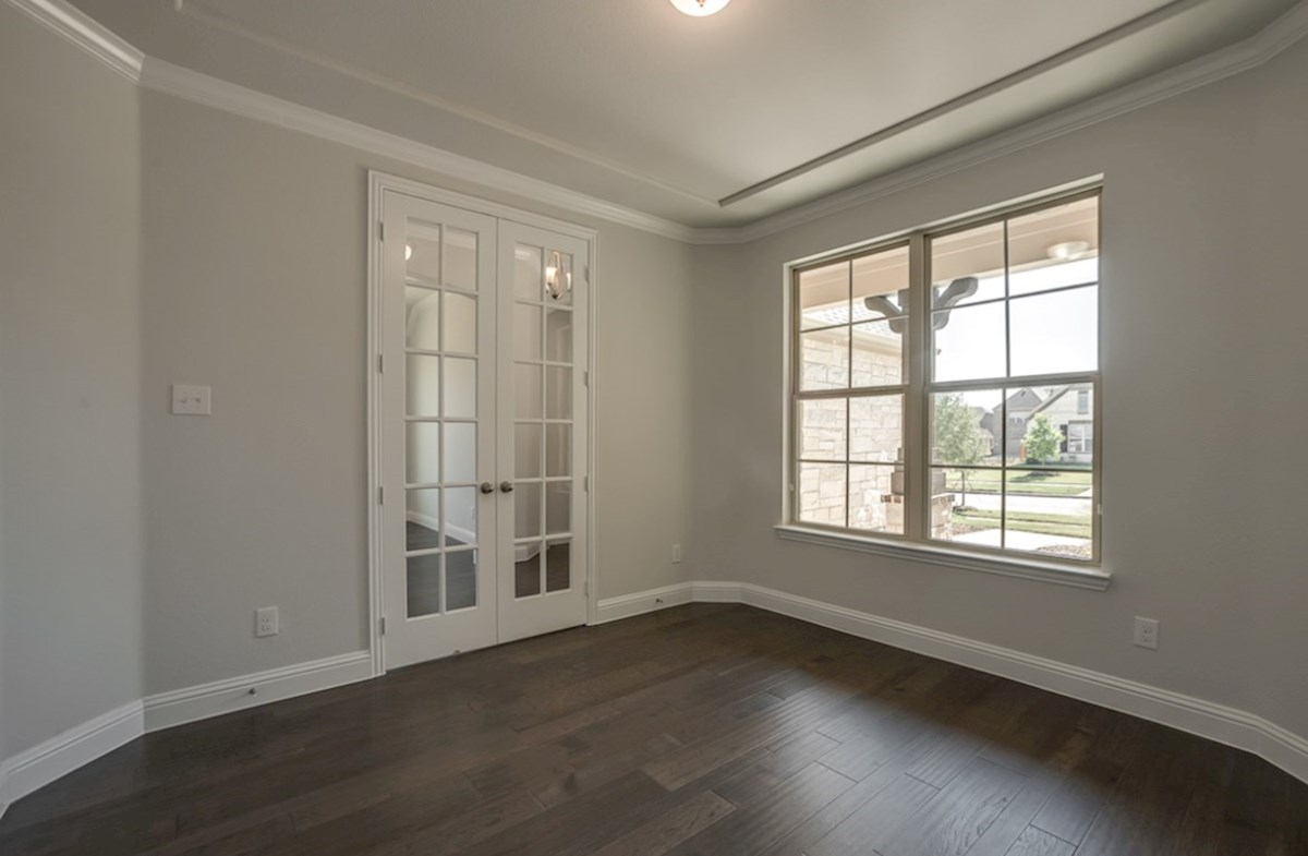 Kerrville quick move-in private study with crown moulding and French doors