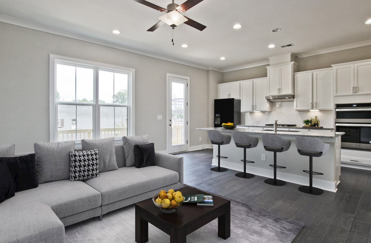Towns at Old Mill Callahan II Family Room with ceiling fan